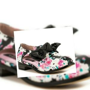 Iron fist buns and roses flats